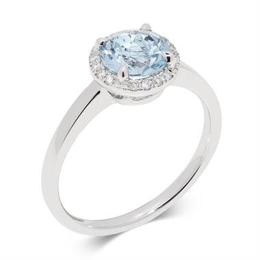 Camellia 18ct White Gold Blue Topaz and Diamond Halo Ring thumbnail