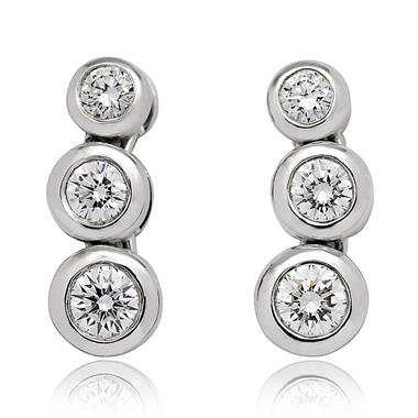 18ct White Gold Three Diamond Graduated Stud Earrings thumbnail