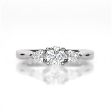 Platinum Round and Pear Shaped Diamond Three Stone Ring thumbnail