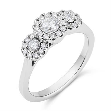 Platinum Graduated Diamond Halo Three Stone Ring thumbnail
