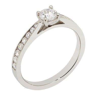 Platinum Tapered Channel Set Shoulder Diamond Solitaire Ring thumbnail