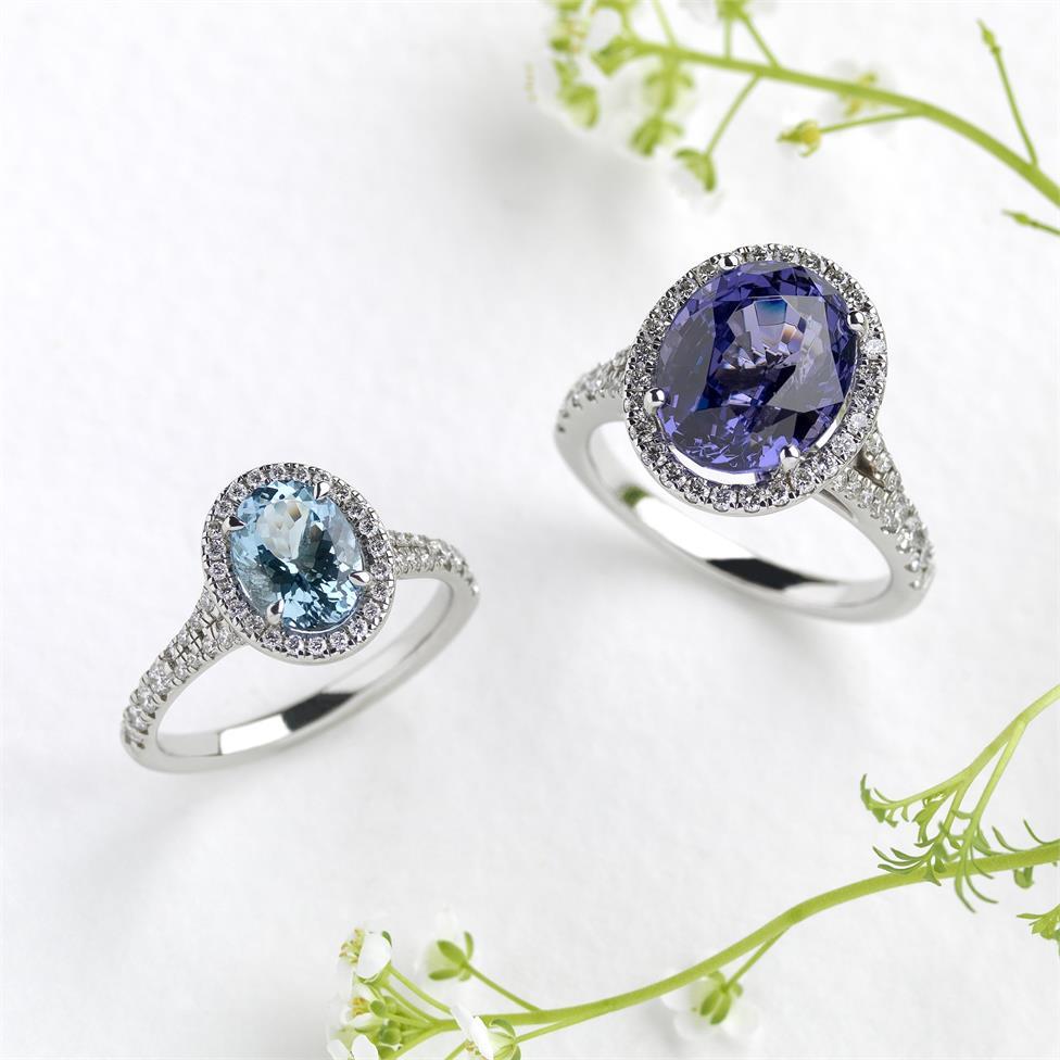 Platinum Oval Aquamarine and Diamond Halo Dress Ring Thumbnail Image 1