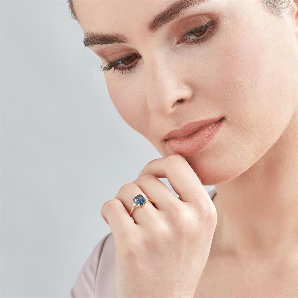 18ct Yellow Gold Light Blue Sapphire and Diamond Three Stone Engagement Ring Thumbnail Image 1