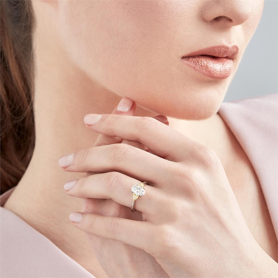 Platinum Oval Cut Diamond and Yellow Diamond Three Stone Engagement Ring Thumbnail Image 1