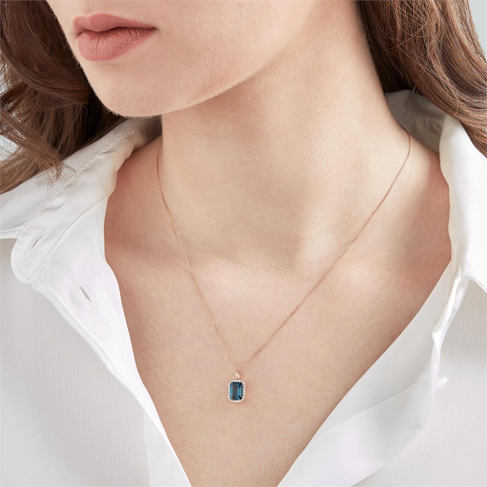 18ct Rose Gold Emerald Cut London Blue Topaz and Diamond Halo Pendant Thumbnail Image 1