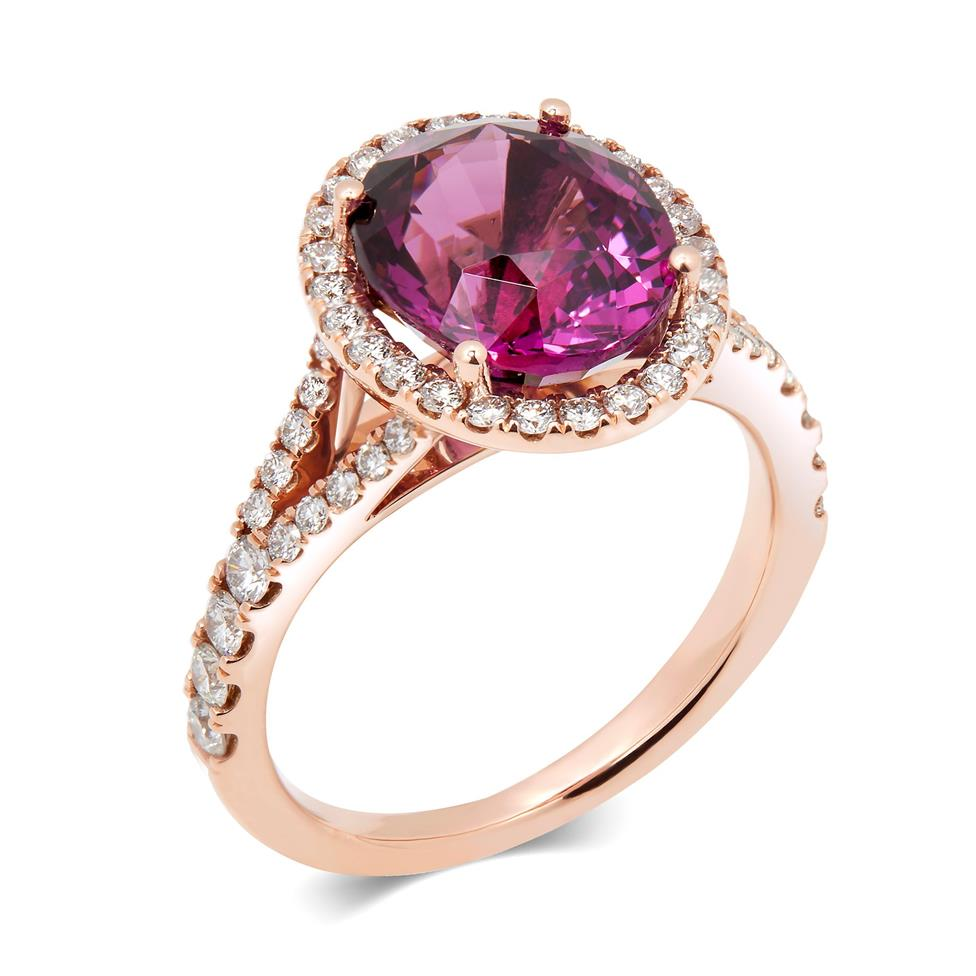 18ct Rose Gold Oval Rhodolite and Diamond Halo Dress Ring Thumbnail Image 0